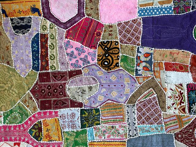 Flerfärgad patchworkmatta
